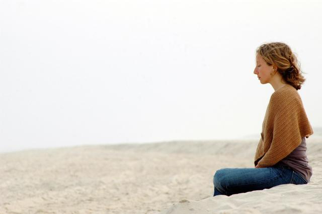 woman-meditating-beach i